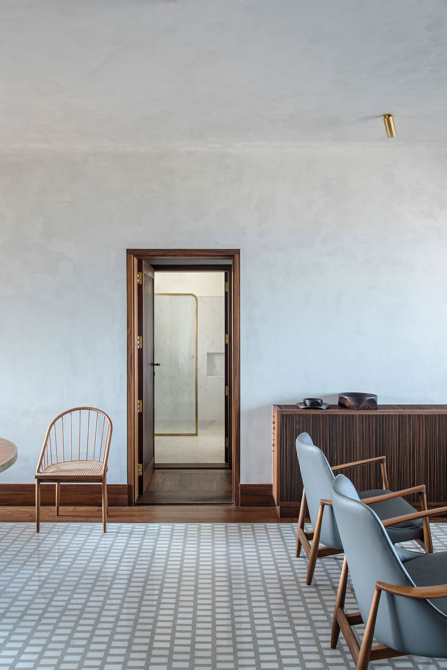 home on malabar hill, mid century modern furniture, terrazzo floor, brass handles, grey walls interior, interior design india