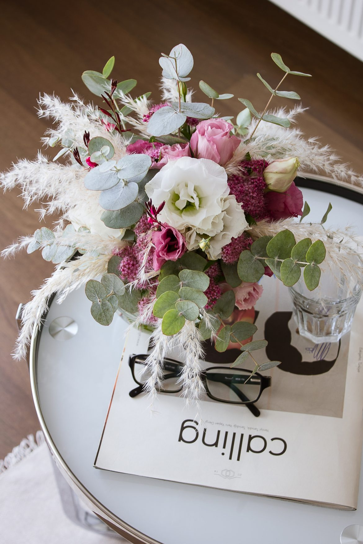 The mix of eucalyptus, white and pink ranunculus and pampas grass